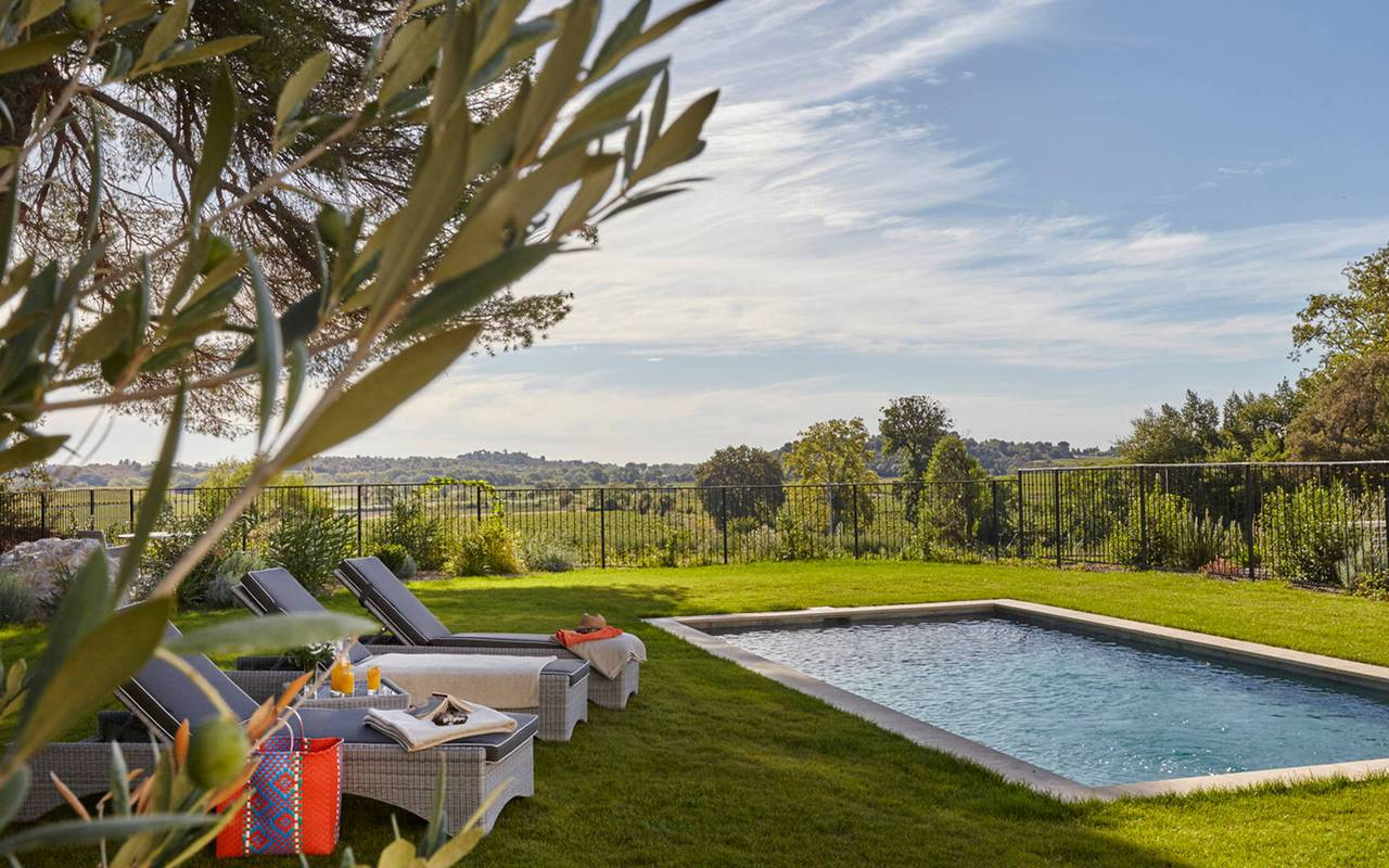 Pool around nature, with sunbeds, in our spa hotel in the Languedoc, Château de Serjac.